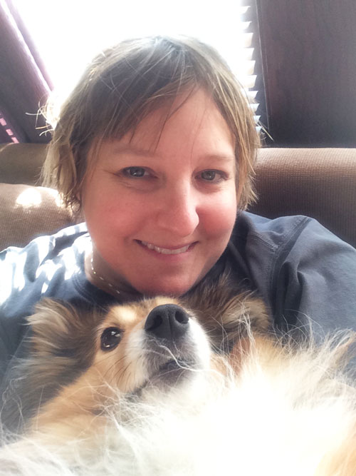 Tami Friday with sitting with her dog Stewart