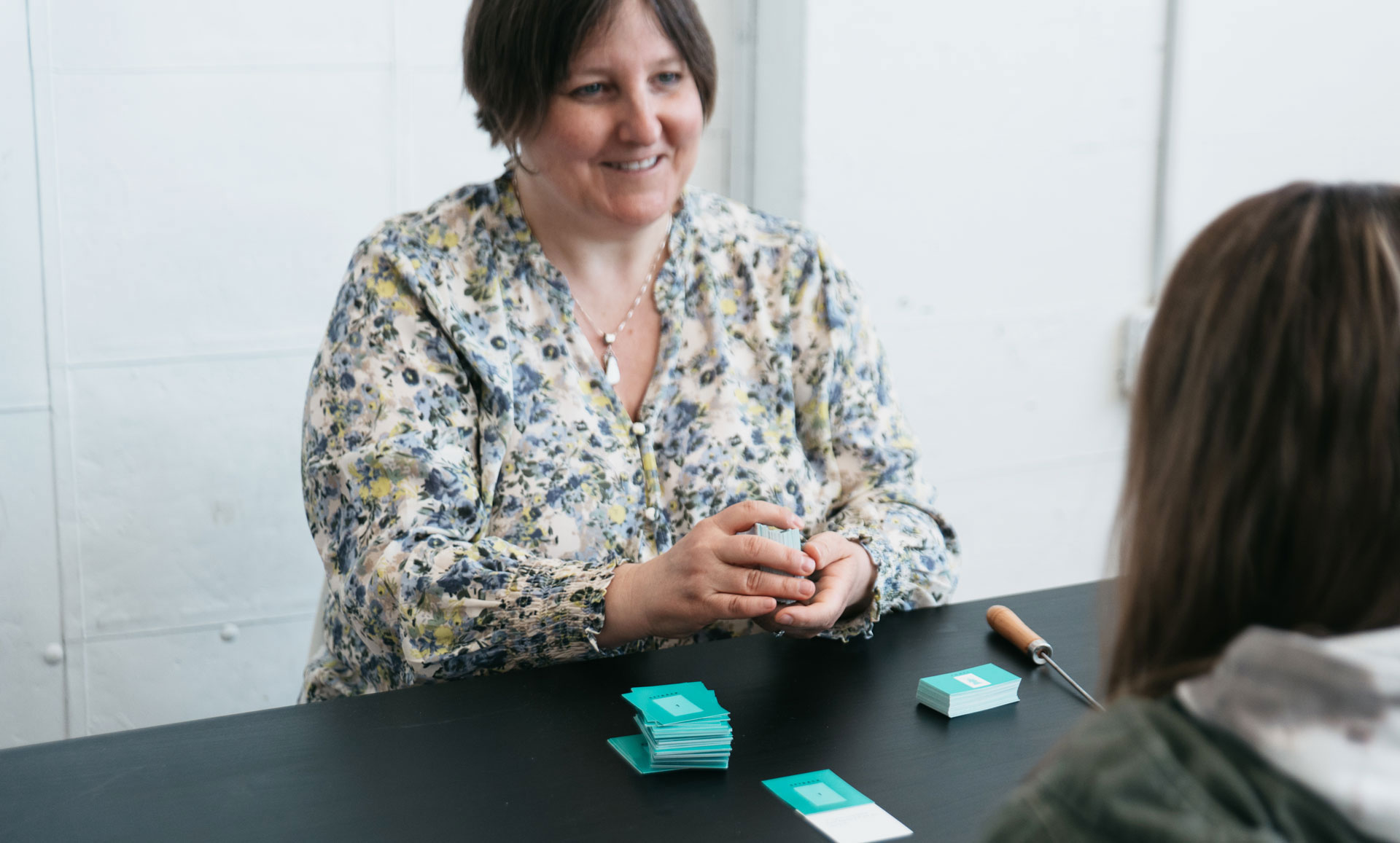 Woman learning how to read insight cards with Tami Friday